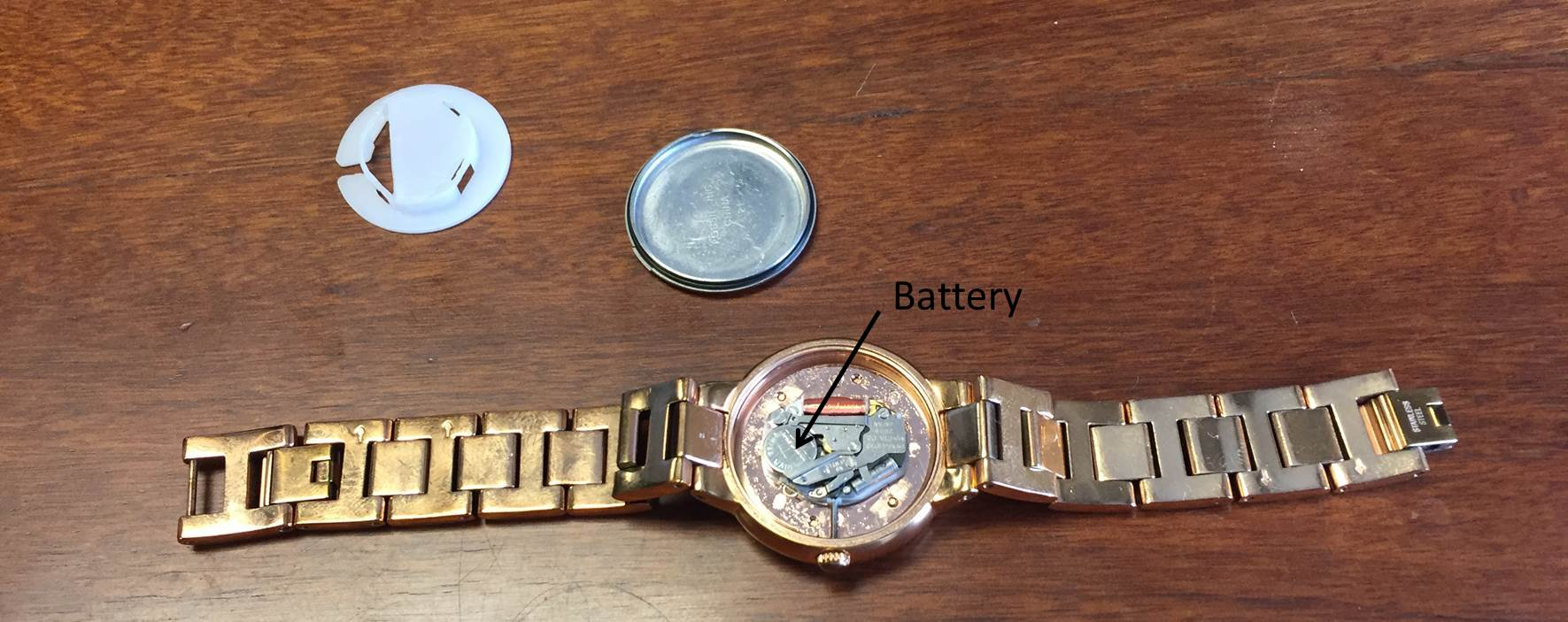 watch-plastic-cover-and-back-removed-battery-indicated