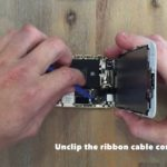 unclip the ribbon cable connector