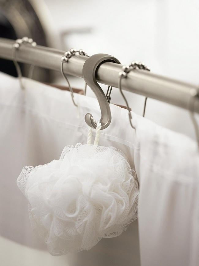 hang a hook on the shower nail to hold shower caddy