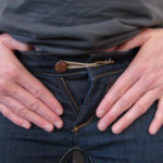 use a rubber band to expand your jeans