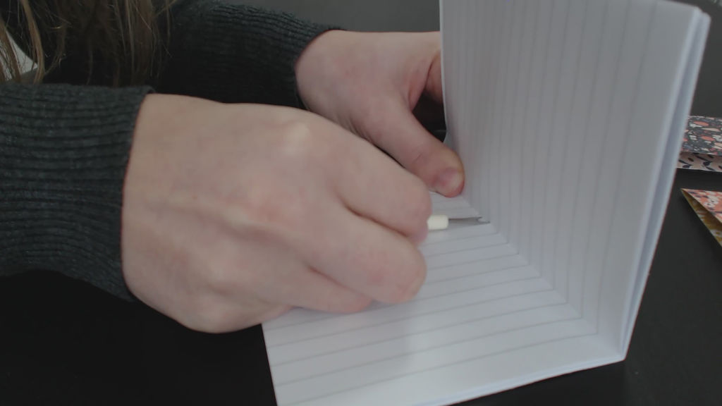 make holes in the notebook spine
