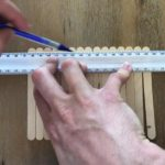 mark off the edges to be cut from the sticks