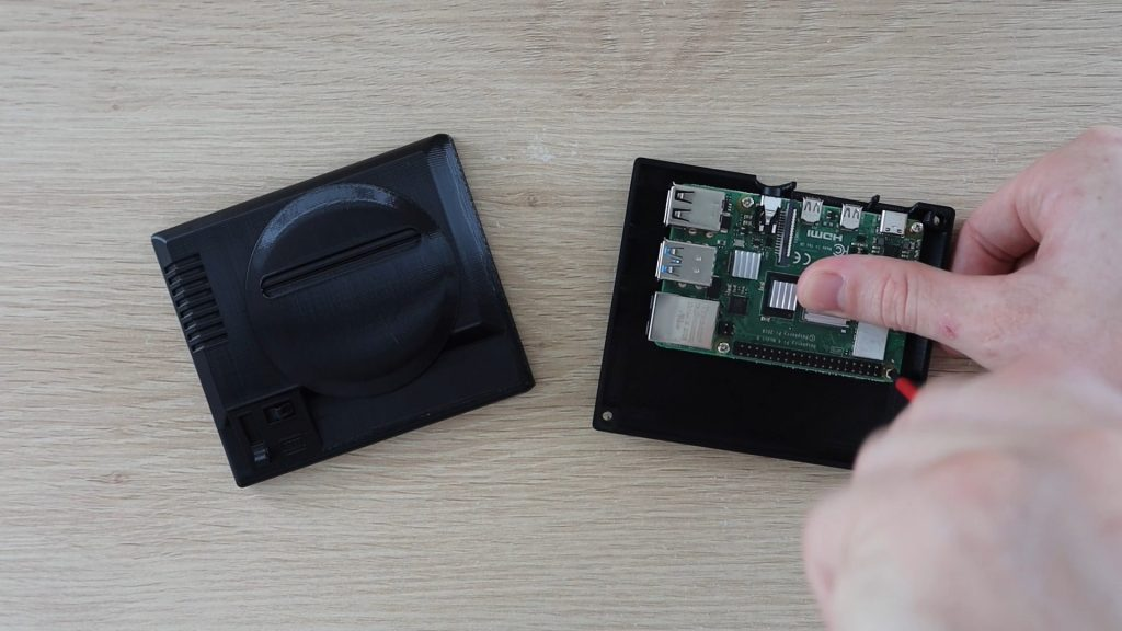 Screw The Raspberry Pi Onto The Bottom Cover